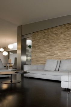 Living Room - Minimalist styling playing with stone textures, woods, shiny metals, natural fabric and cork flooring. Simplistic harmony well executed!.