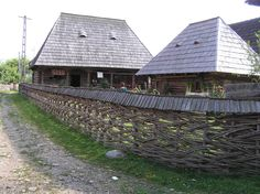 Continuous weave wattle fence, herringbone design with wood shake top. Maramures, Romania. Image by Myra Lea. flickr.com
