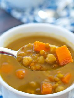 This Crockpot Vegan Coconut Curry Chickpea Lentil Soup is the easiest soup to make and is full of flavor! Low calorie, too!