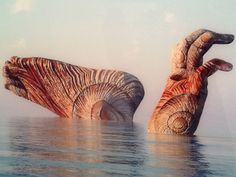 Surreal bodyparts emerging from the sea by Kim Joon...  See more here: http://www.justfollowthewhiterabbit.com