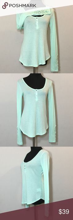 """Anthropologie Eloise Crochet Henley Thermal Size S Anthropologie Eloise Crochet Henley Thermal Size Small. New without tags! Long sleeved with amazing crochet cuffs. Beautiful pastel green. Three button henley style. Look and feel is very similar to waffle knit thermal. Bust 36"""" (91cm). Length 25"""" (64cm). Eloise Tops Blouses"""