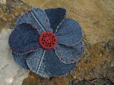 Recyled denim jeans flowers....they would be cute on a bunch of projects....like the extra stitching for color and a vintage button for charm. Lots of ideas here to use old jeans.