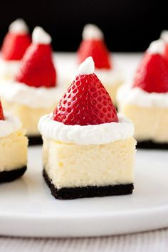 Santa Hat Cheesecake Bites - these are a hit at parties. Festive and delicious! Santa Hat Cheesecake Bites - these are a hit at parties. Festive and delicious! Christmas Party Food, Xmas Food, Christmas Cooking, Christmas Treats, Holiday Treats, Christmas Hat, Christmas Cakes, Chrismas Food Ideas, Merry Christmas