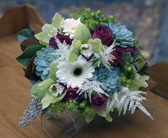 Autumn bridal bouquet of succulents, astilbe, seeded eucalyptus, hypericum berries, roses, gerbera and cymbidium orchids