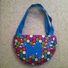 Duct tape purse made using 2paper plates and patterned duct tape!
