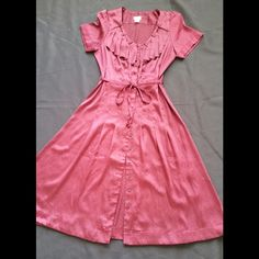 """New H&M Retro Glam dress Brand new without tags. 42"""" Long. 13 buttons in the front. 100% Polyester. You can wear as Cloak with the short  or Classic dress.   No trade. I do not respond ❤️Make an offer. Do not ask for lowest H&M Dresses"""
