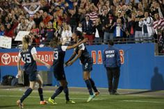 Sydney Leroux celebrates her goal against Canada with Christen Press and Morgan Brian. (Cooper Neill/Getty Images North America)