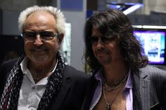 Kelly Hansen Photos Photos - (L-R) Mick Jones and Kelly Hansen of the band Foreigner walk around the trading floor before ringing the opening bell at the New York Stock Exchange on October 21, 2009 in New York City. - Foreigner Rings The NYSE Opening Bell