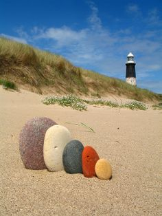 Colorful beach stones in a row.  - Oh I wish to come somewhere on a beach - our little Lake Balaton has no Stones!