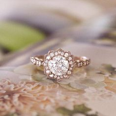 Weddbook ♥ Sparkling rose gold halo diamond ring that is so beautiful that you…