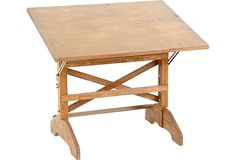 intage wood drafting table with adjustable-angle surface.