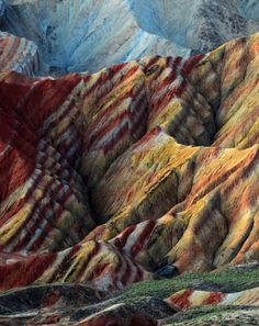 Zhangye Danxia Landform, Gansu, China These colourful rock formations are the result of red sandstone and mineral deposits laid down over 24 million years. Wind and rain then carved amazing shapes into the rock, forming natural pillars, towers, ravines, valleys and waterfalls.