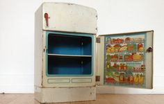 "What once used to be a very disappointing gift for a child can now be a nifty decorative piece for your kitchen!    Description: Vintage Wolverine child's toy refrigerator. Stands 13"" tall both doors open to reveal fridge and ice box space."
