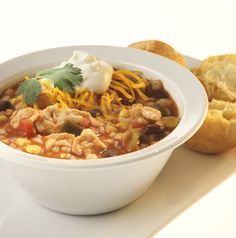 Transport Chicken Chili to your tailgate in a slow cooker or reheat it in its pot on the grill. Be sure to pack all those chili toppings: shredded cheese, sour cream, jalapenos, etc.