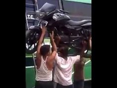 Like a Boss of the Day: Indian Superman Loads Motorcycle Onto Bus in an Unorthodox Way
