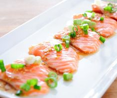 Salmon Carpaccio.In this recipe raw salmon gets a unique taste,through with the addition of dill and a confetti of fresh onion and radish for textual contrast.