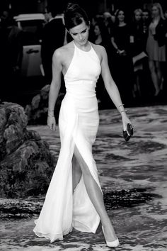 White gown with a slit ! And it shows off the shoulders beautifully