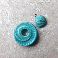 Stoneware ammonite donut focal with matching shell charms in a gorgeous soft matt turquoise glaze... by Lesley Watt.