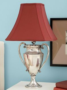 trophy transformed to a lamp..cheap find at the thrift store, add a lighting kit and instant glam.