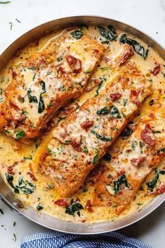 - Smothered in a luscious garlic butter spinach and sun-dried tomato cream sauce, this Tuscan salmon recipe is so easy, quick, and simple. - by Creamy Garlic Tuscan Salmon With Spinach and Sun-Dried Tomatoes - Salmon Dishes, Fish Dishes, Seafood Dishes, Salmon Meals, Keto Salmon, Shrimp Meals, Parmesan Salmon, Salmon Food, Food Dinners
