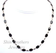 (http://shop.shinjewelers.com/14k-yellow-gold-16-onyx-chain-necklace-32000131/)