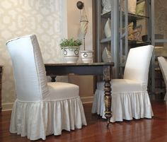 Quatrine Farmhouse table and Parsons dining chairs with full ruffle skirts