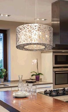 Be amazed by the Crystal Nest light fixture's modern design with decorative laser cut metalshade.  The stunning chrome finish with hand cut crystal beads will provide a tranquil ambiance to your home.