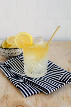 Whiskey Lemonade - Whiskey, Lemonade, Honey Sticks, Lemon Slices.