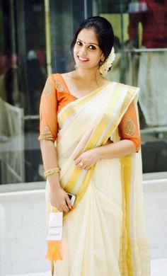 Looking for Kerala saree (kasavu saree) blouse designs? Here are gorgeous models/ideas for you choose the right one to look stunning. Kerala Saree Blouse Designs, Saree Blouse Neck Designs, Saree Blouse Patterns, Onam Saree, Kasavu Saree, Simple Sarees, Trendy Sarees, Stylish Sarees, Saree Accessories