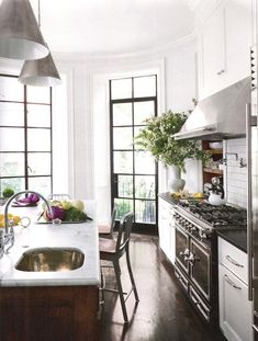 Nina Farmer kitchen | White cabinets and walnut islan
