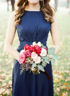 "I really like the way this looks against the navy bridesmaid dress, but it perhaps has more of a ""winter"" feel to it?"