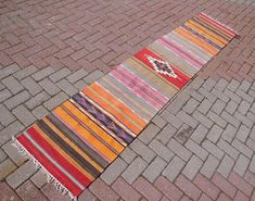 Check out this item in my Etsy shop https://www.etsy.com/listing/549369218/turkish-kilim-runner-colorful-runner