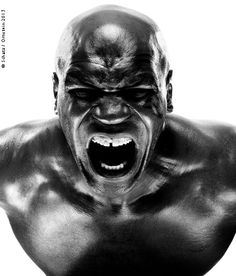 Mike Tyson, retired champion, photographed for Sports Illustrated in Las Vegas, May 2010. We made images that were tough and serious, and then I asked him to make something ferocious and shocking for the camera. He obliged.