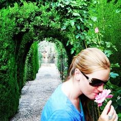 {Me} Here I am taking some time to literally stop and smell the roses while walking through the gardens of the Alhambra in Granada Spain. (Do look the Alhambra up on #lonelyplanet and read about it for yourself- it's an amazing place that I could go on about forever). So I've been nominated to do #fivefunfacts about myself from @theadventurousmummy.  1. I have been skydiving and climbed the #SydneyHarbourBridge however that wasn't enough to cure my fear of heights. I cannot get too close to…