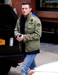 Pictured in New York City on October 11th, 'Dracula Untold' actor Luke Evans wore Diesel's J-Amma Military Jacket with a pair of casual distressed denim jeans.