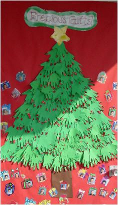 I did this on my door and it turned out to be really cute.  For the lights I had them use their fingerprints with silver, gold and red ink pads. Door decoration or bulletin board  Handprint Christmas tree