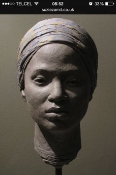 Amina All (clay), one of the kidnapped Nigerian schoolgirls; sculpture by Suzie Zamit