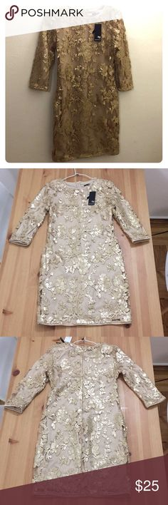 TFNC London Gold Dress TFNC London mini dress Gold/Nude - Glittery Never worn ! Still has tag attached Size 12 but fits small TFNC Dresses Mini