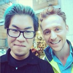 """Is it just me or does Tom look like he's photo-bombing this fan's picture? The guy was probably like """"Screw it, it's TH, he does what he wants anyways."""""""