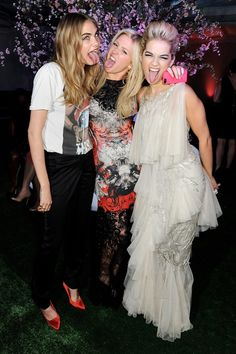 Cara and Rita made silly faces with Ellie Goulding, middle, for a funny picture