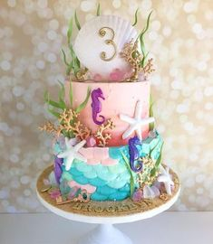 """✨""""Look at this stuff, isn't it neat..."""" ✨A mermaid cake for Brooklyn adorned with gadgets and gizmos aplenty! #underthesea #treasuresuntold #dinglehopper #mermaidcake"""