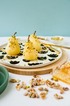 Boozy poached pears with drizzled honey and pistachios. #summer #autumn #desserts