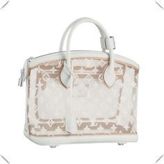 *Shiny palladium brass metallic pieces *Natural cowhide leather interior trimmings *D-ring for keys or accessories *Interior zipped pocket  Description: The Lockit in exquisite Monogram Transparence embodies fresh,feminine charm.Adorned with a delicately embroidered Monogram pattern,radiant white calfskin leather trimmings enhance its iconic shape.  Material: Leather Fuction: Fashion Show Collections Model: M40699 Color: White Size15.4 x13.8 x 6.3 inches