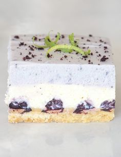 These striking Blueberry and Lime bars are made up of a crisp lime shortbread, topped with blueberries in a creamy lime cheesecake layer, and finished with a layer of bright blueberry mousse. A real show-stopper to wow your guests! Fun Baking Recipes, Best Dessert Recipes, Easy Desserts, Drink Recipes, My Recipes, Sweet Recipes, Delicious Desserts, Yummy Food, Lime Cheesecake