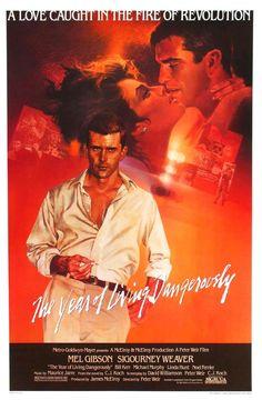 """The Year of Living Dangerously"" (1983). COUNTRY: Australia. DIRECTOR: Peter Weir. (Novel: C.J. Koch). CAST: Mel Gibson, Sigourney Weaver, Linda Hunt, Michael Murphy, Bill Kerr, Noel Ferrier"