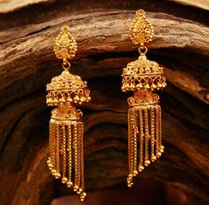 Khazana Jewellery offers exquisite collection of Gold Jewellery Designs for women. We are one of the Top jewellers in India having beautiful Indian bridal necklace & bridal jewelry sets with latest designs from our stores. Gold Jhumka Earrings, Gold Bridal Earrings, Gold Earrings Designs, Gold Jewellery Design, Bridal Jewelry Sets, Bridal Necklace, Gold Jewelry, Chain Jewelry, Bridal Jewellery