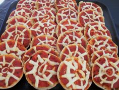 "Halloween - mini spider web pizzas (english muffins, pizza sause, string cheese, olive ""spiders"")"