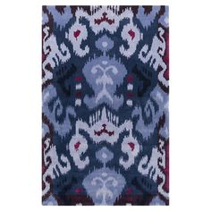Anchor your dining set or living room seating group in chic style with this hand-tufted rug, showcasing an eye-catching ikat motif in violet and blue.