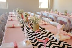 Black and white chevron table runners, pink cloths and gold glitter mason jars