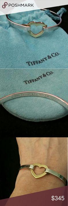 Tiffany & Co. 18 kt and Sterling Heart Hook Bangle Authentic  Tiffany & Co. Heart hook bangle.  Heart is 18 kt gold and bracelet is sterling silver.  Tiffany & Co. hallmark on inside back of bracelet.  Perfect condition!  Size small. Tiffany & Co. Jewelry Bracelets